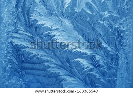 Frosty pattern at a winter window glass  - stock photo