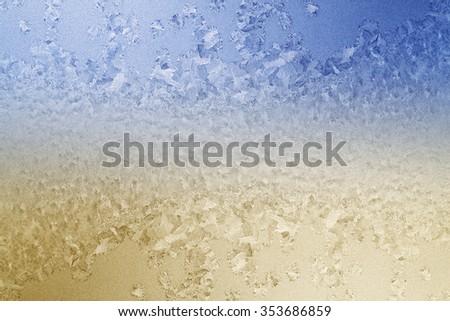 Frosty pattern on glass closeup - stock photo