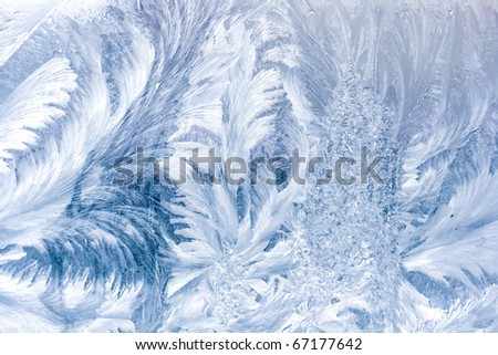 Frosty pattern on window in winter season - stock photo