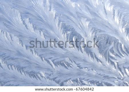 Frosty pattern on window in winter season - stock photo