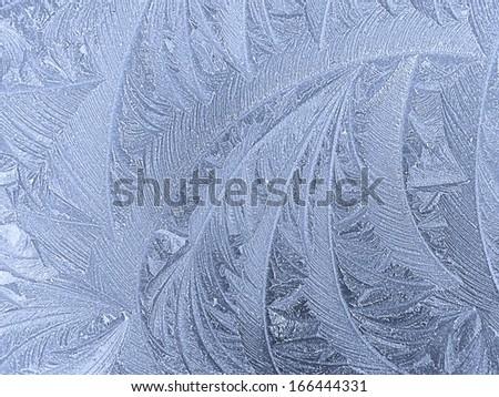 Frosty patterns on glass. Winter background. - stock photo