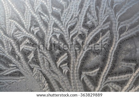 Frosty patterns on the window glass - a wonderful and mysterious creation of nature - stock photo