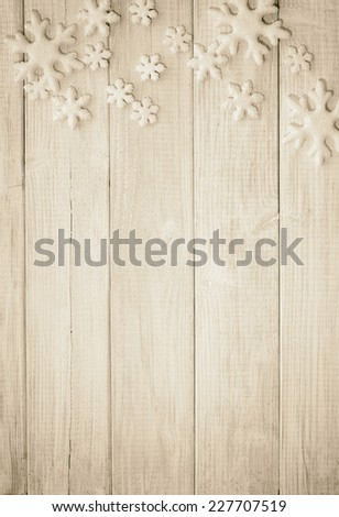 Frosty Snowflake Ornaments on Rustic Wood Board Background with empty room or space for copy, text, your words. Vertical sepia vintage, old-fashion tone - stock photo