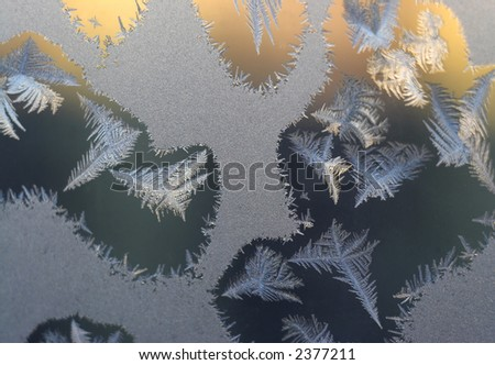 Frosty tracery on the pane - stock photo