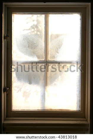 Frosty window. From the inside looking out. - stock photo