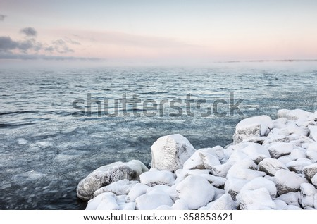 Frosty winter day next to lake - stock photo