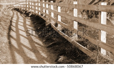 frosty winters view at ballybunion cliff side walk with atlantic view and fence shadows