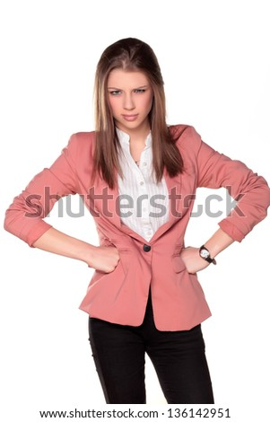frowning and angry teenager girl with hands on the waist - stock photo