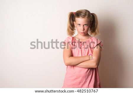 frowning naughty girl arms crossed sad stock photo (royalty free