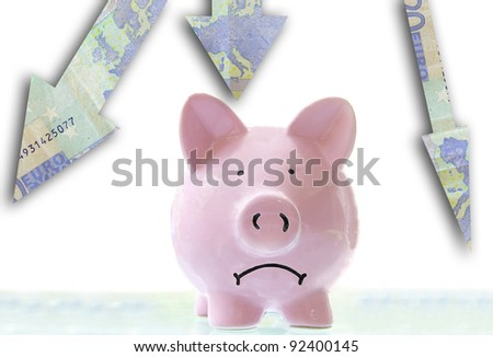 frowning pink piggy bank down Euro arrows - stock photo