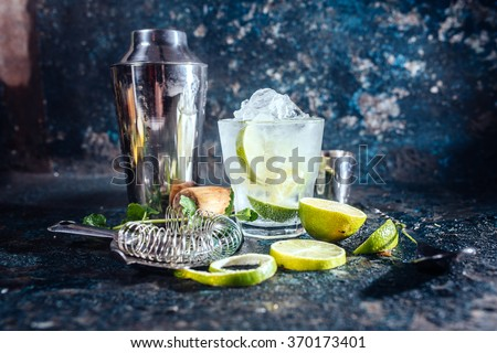 frozen alcoholic cocktail, refreshment drink with vodka and lime served at bar - stock photo