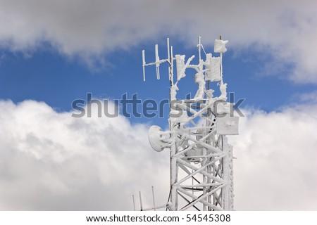 Frozen antenna over a cloudy sky - stock photo