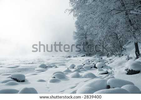 Frozen bank of river - stock photo