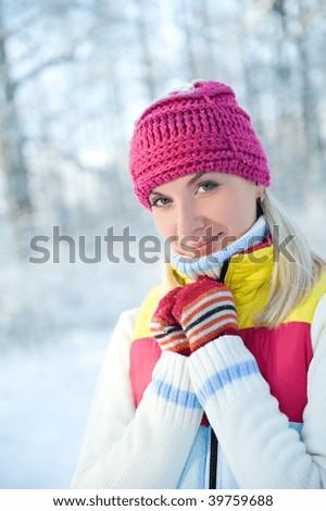 Frozen beautiful woman in winter clothing outdoors - stock photo