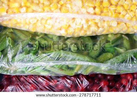 Frozen berries and vegetables in bags close up - stock photo