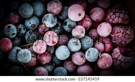 frozen berries, black currant, red currant, raspberry, blueberry. top view. macro