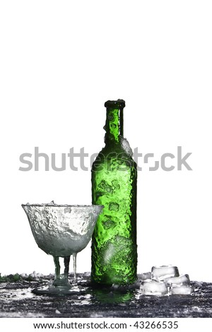 frozen bottle and glass with ice cubes cold drink isolated - stock photo