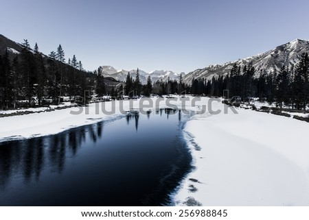 Frozen Bow River at Banff, Alberta, Canada