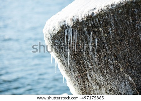 Frozen breakwater at Baltic Sea, Europe. Winter sea and mole