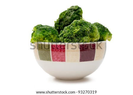 frozen broccoli in a bowl on white background - stock photo