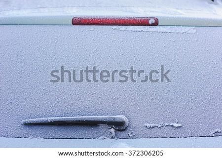 Frozen car window - stock photo