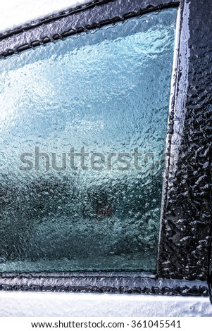 Frozen car window after a blizzard - stock photo