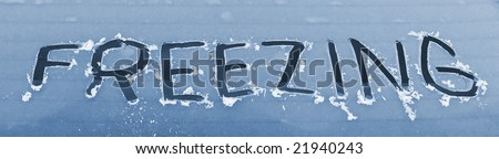 frozen car window with the word freezing - stock photo