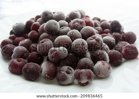 frozen cherries isolated on a white background - stock photo