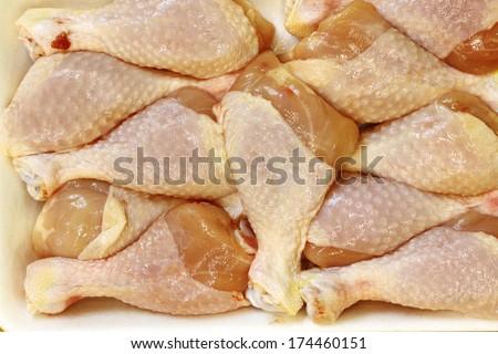frozen chicken legs in a Styrofoam packing - stock photo