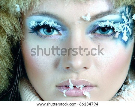 Frozen. Close-up portrait of chilled female face - stock photo