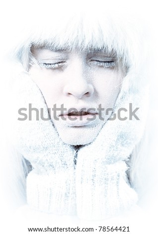 Frozen. Close-up portrait of chilled female face covered in ice. - stock photo