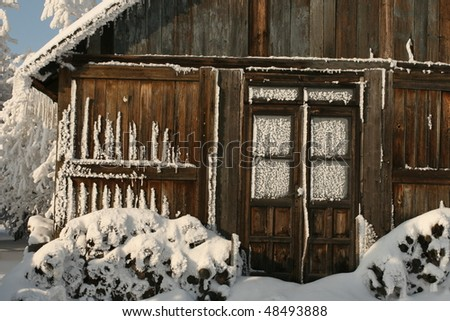 frozen cottage - stock photo