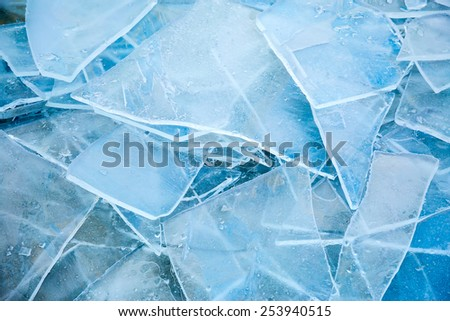 Frozen cracked ice background - stock photo