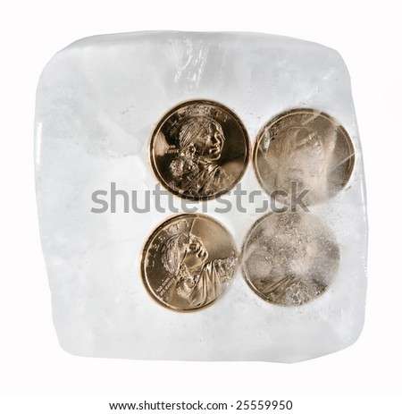 Frozen Currency: Four American Dollars Frozen in Ice - stock photo