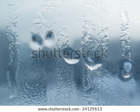 Frozen drops of water on a window pane - stock photo