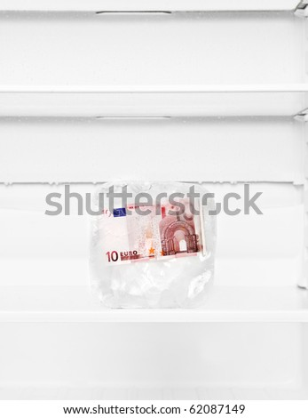 Frozen Euro Bank-note in a fridge - stock photo