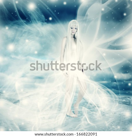 Frozen fairy woman in white wind dress on snow and blue winter background - stock photo
