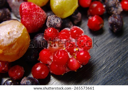 frozen fruit on a wooden surface - stock photo