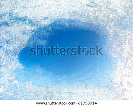 frozen glass with the thawed hole - stock photo