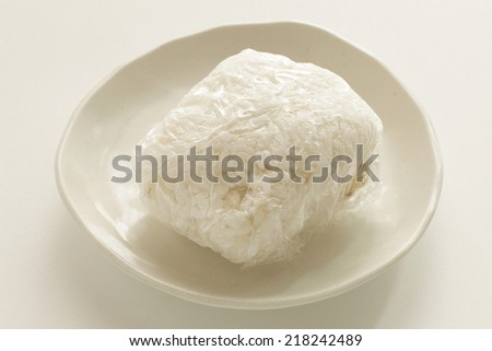 frozen grain wrapped by clingy plastic wrap  - stock photo