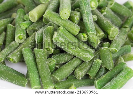 Frozen green beans located on the whole close up - stock photo