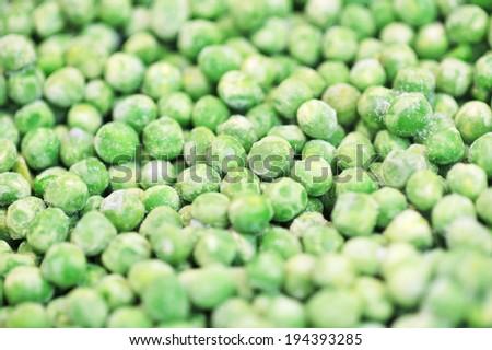 frozen green peas background - stock photo