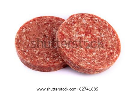 Frozen hamburger patties against white background - stock photo
