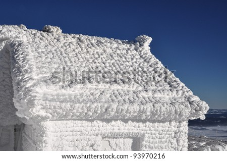 Frozen house at winter - stock photo