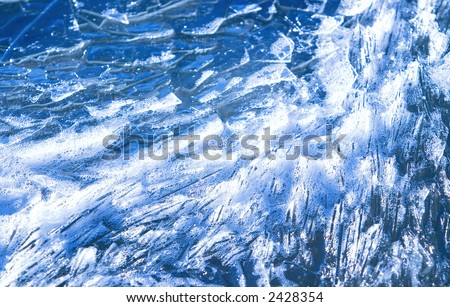 Frozen Ice Shards Flowing In Water With Bubbles - stock photo
