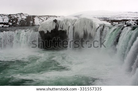 Frozen Icelandic waterfall - Godafoss - stock photo
