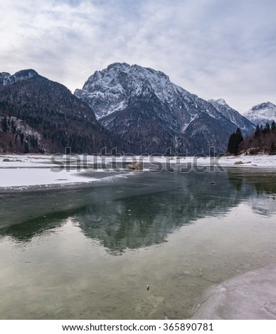 Frozen lake at lago di Predil