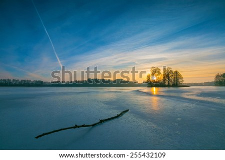 frozen lake at sunrise landscape - stock photo