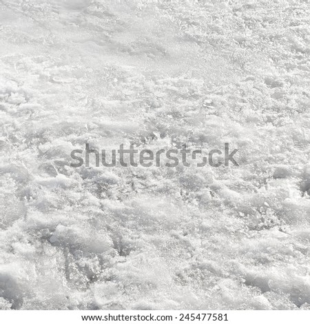 Frozen lake covered by a snow in winter - stock photo