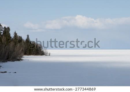 Frozen lake in winter, Lake Winnipeg, Riverton, Hecla Grindstone Provincial Park, Manitoba, Canada - stock photo